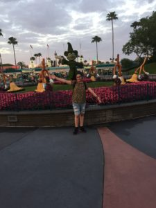 Standing with the Mickey Statue at the Entrance of Hollywood Studios.