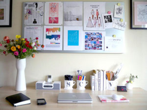 A very simple yet motivating work space nicely decorated.